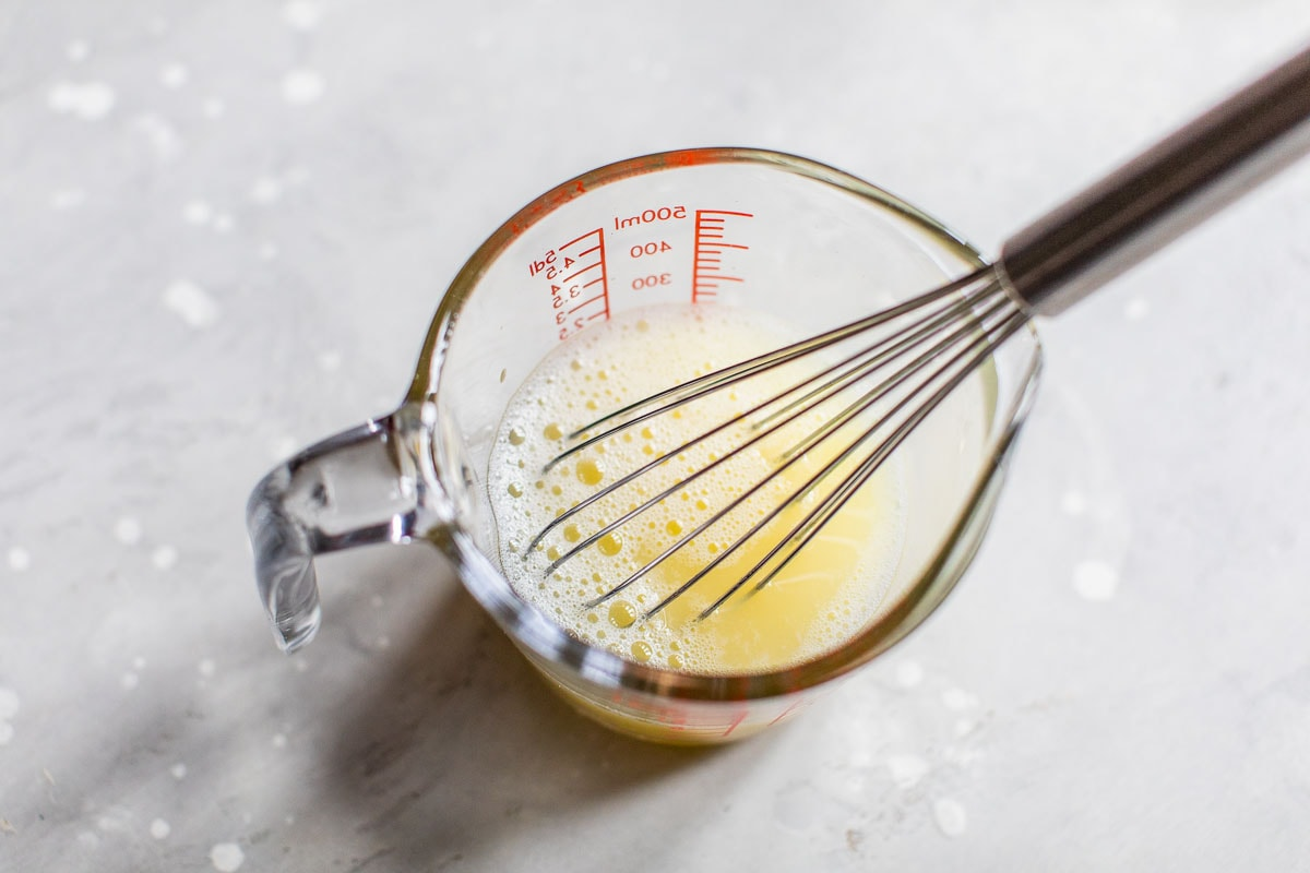 Eggs being whisked in a measuring cup