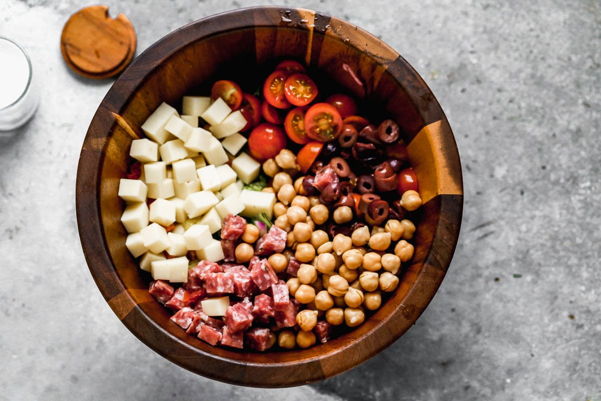 Various ingredients in a bowl for Italian chopped salad