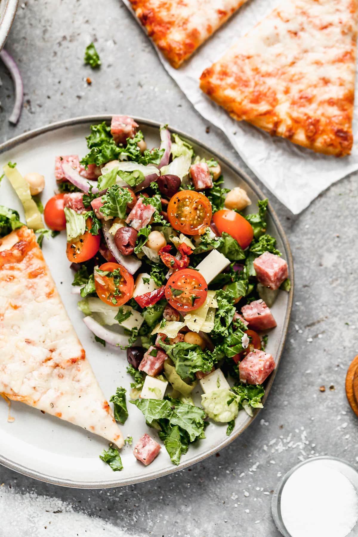 Pizza and Italian chopped salad on a plate