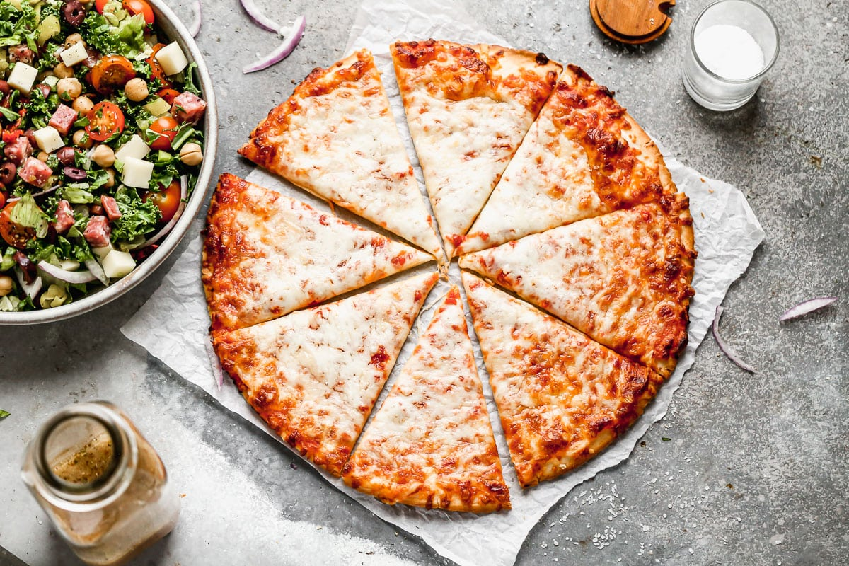 A cheese pizza cut into slices