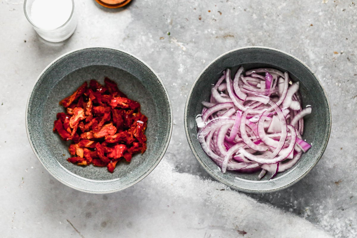 A bowl of sun-dried tomatoes and onions