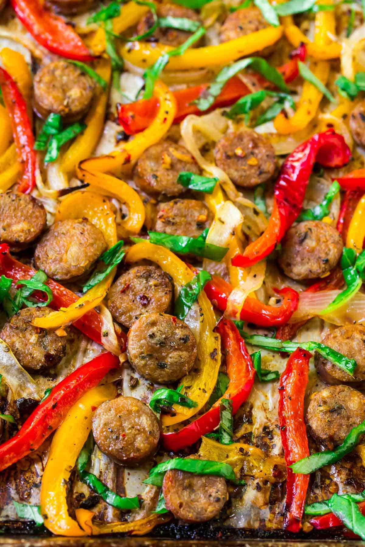 Easy, healthy sheet pan Italian Sausage and Peppers. Use for a sausage and peppers sandwich, over pasta, with rice, or on its own.