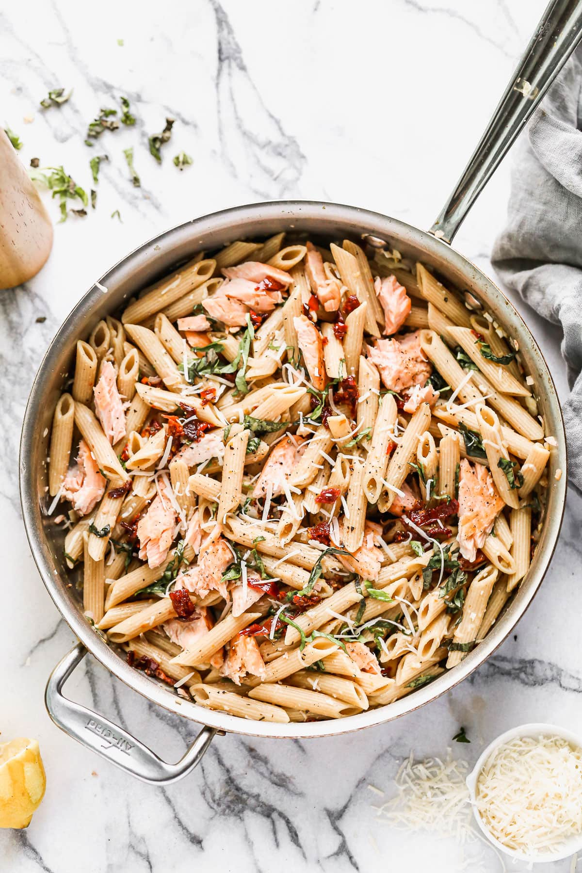 Salmon pasta in a pot with cheese