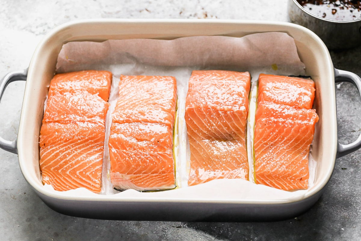 Four fish fillets in a baking dish