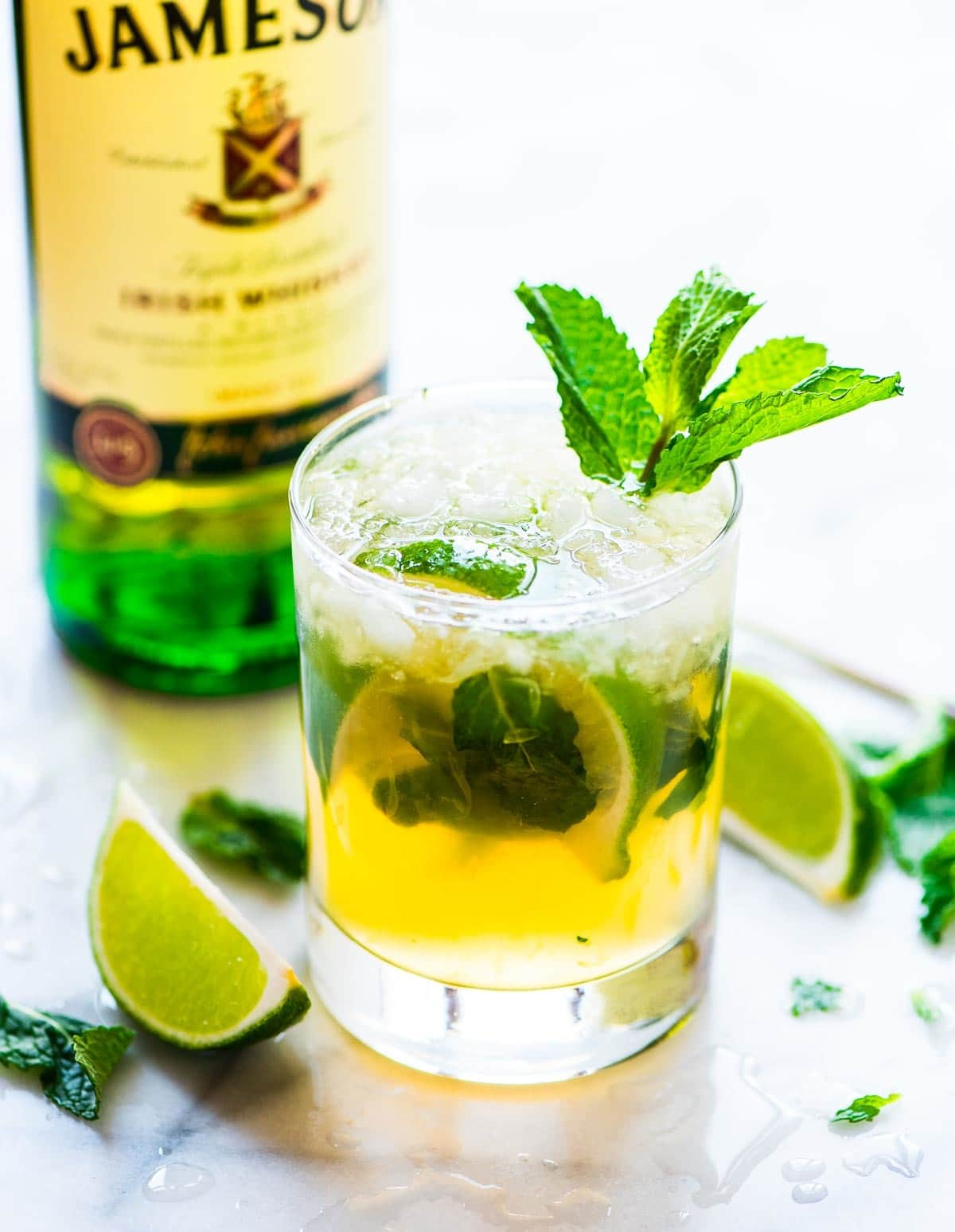 Green whiskey smash in a glass