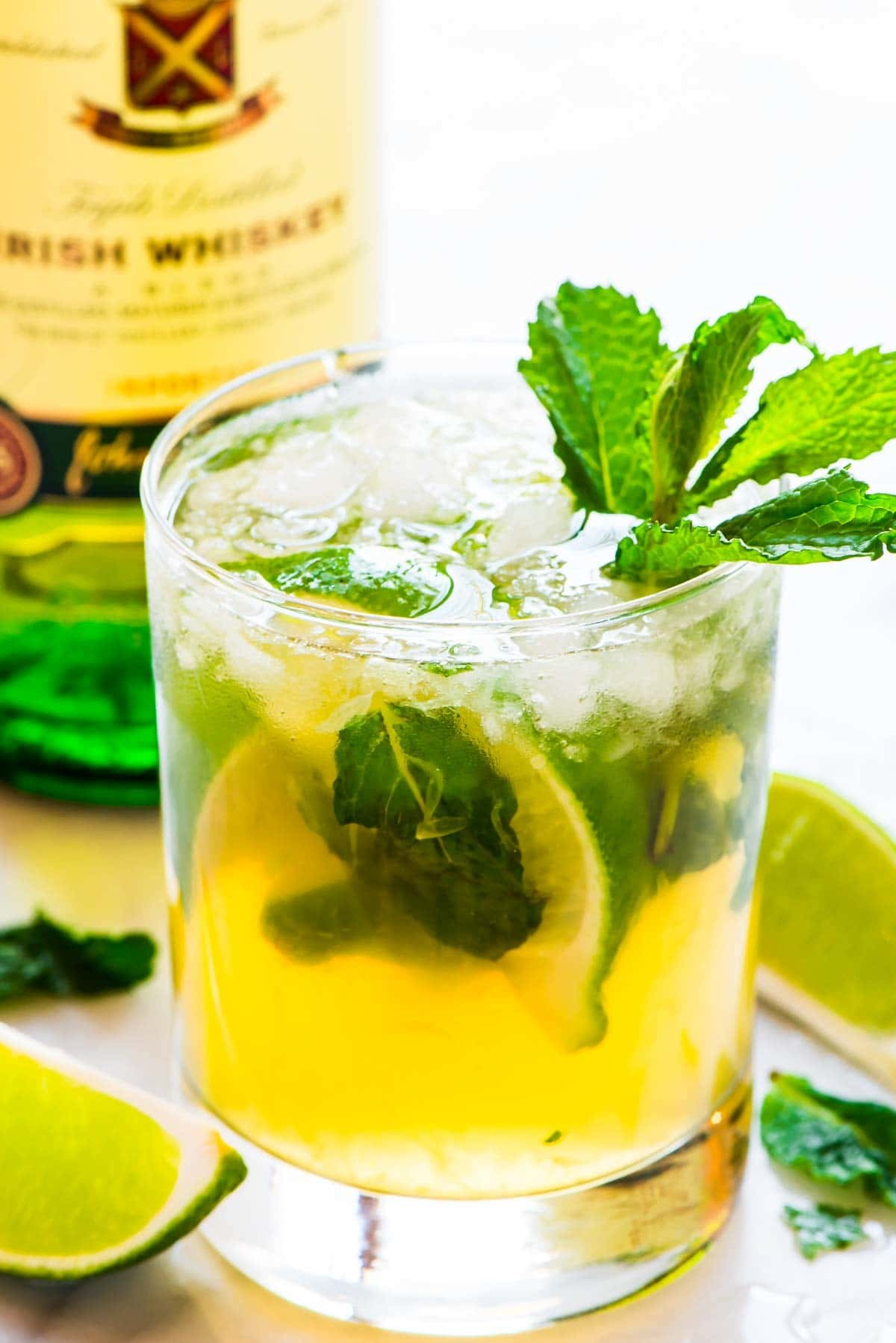 A green cocktail with mint leaves