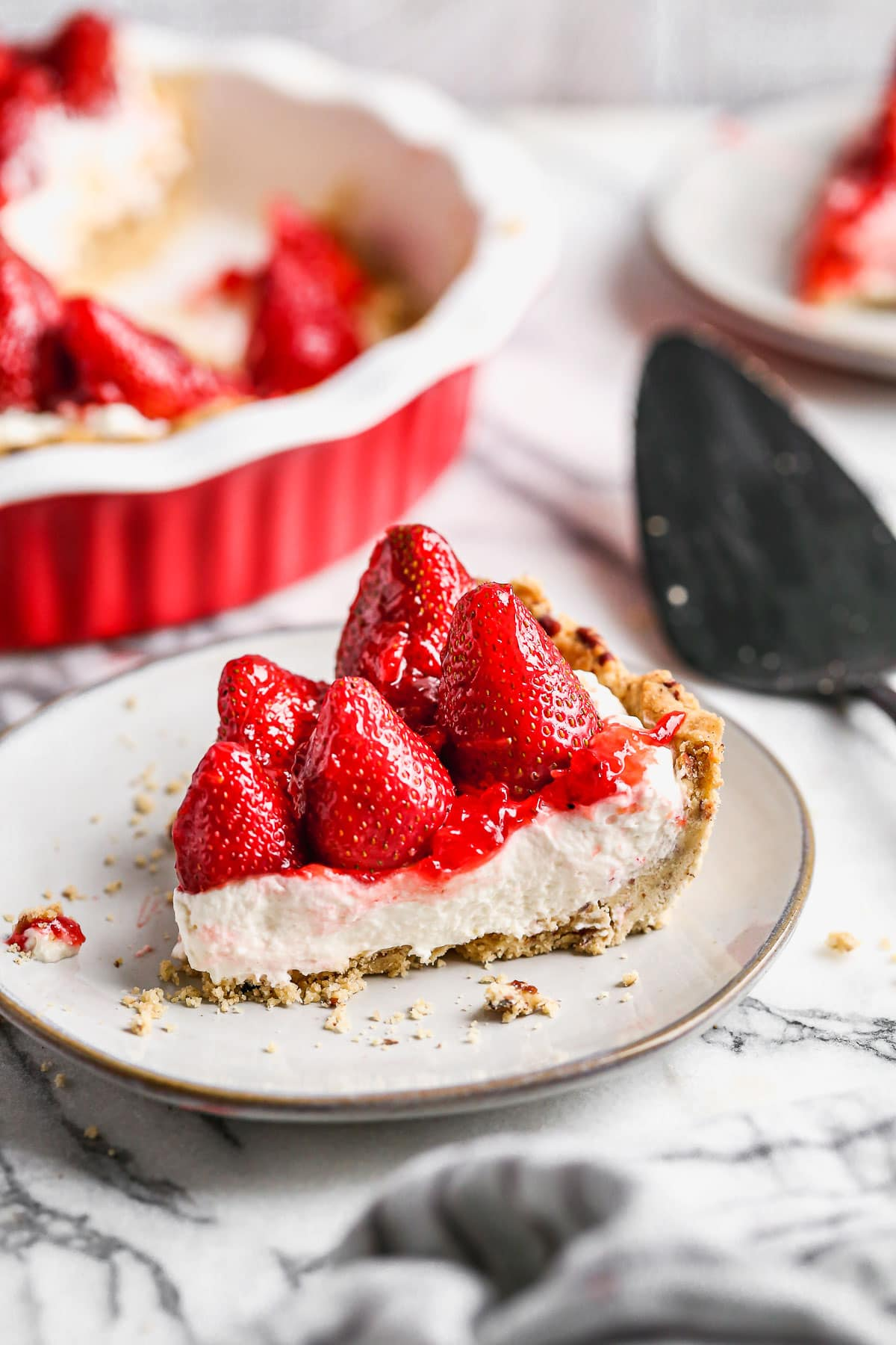 A slice of strawberry cream cheese pie on a plate