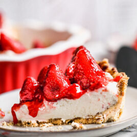 A slice of strawberry pie with cream cheese