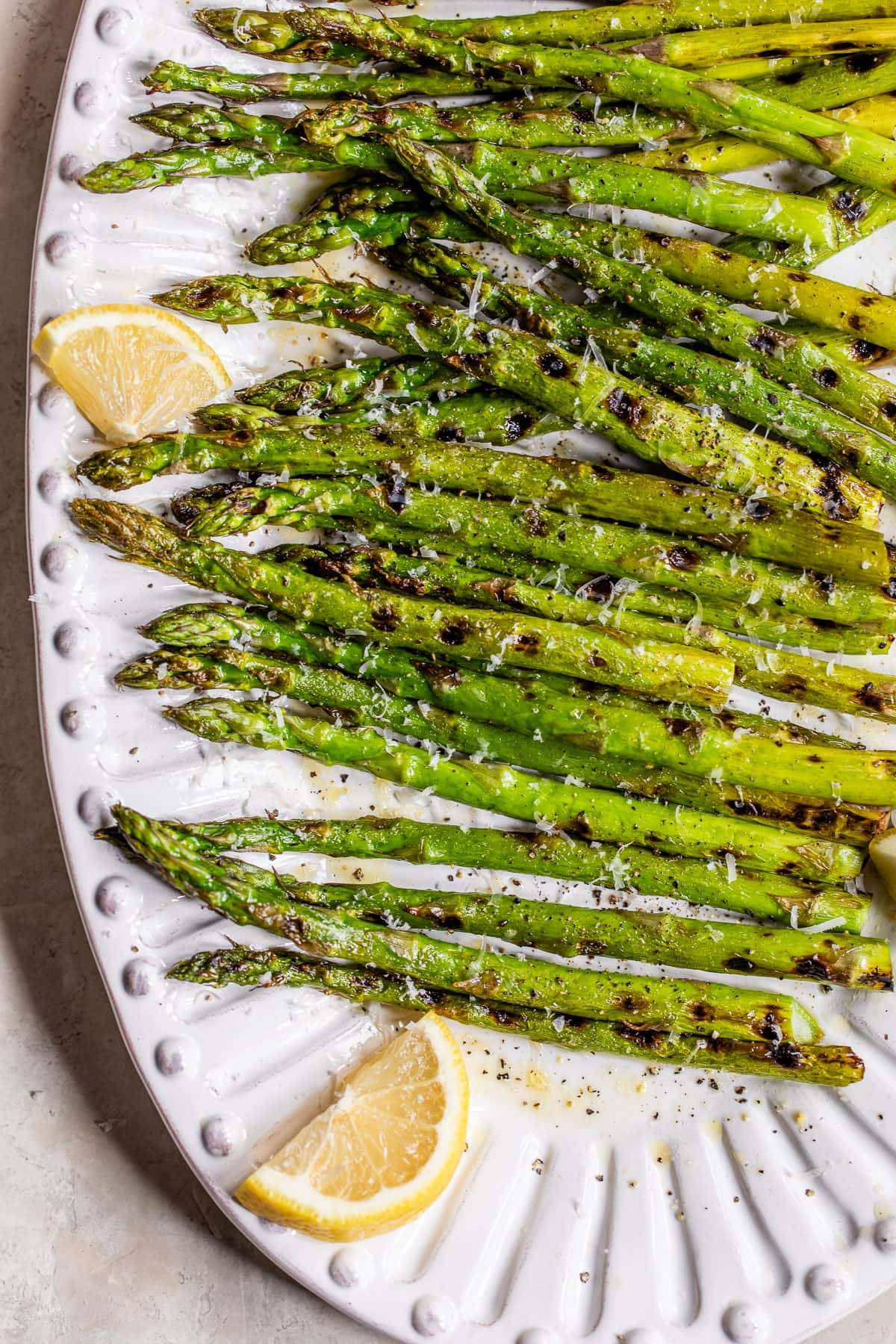 Grilled asparagus with lemon and Parmesan on a plate