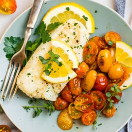 Easy pan fried cod with tomatoes and lemon