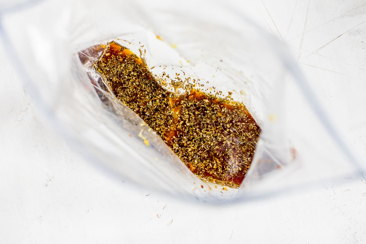 Lemon juice, oil, soy sauce, and spices in a bag