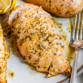 Chicken breasts on a plate with a lemon soy marinade