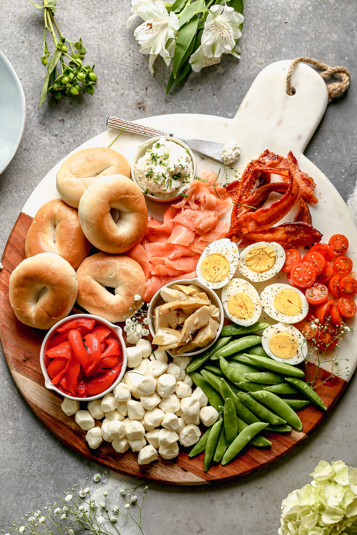 a large cutting board with savory brunch items