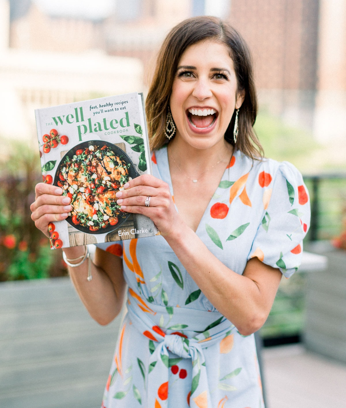 Erin Clarke holding the Well Plated Cookbook