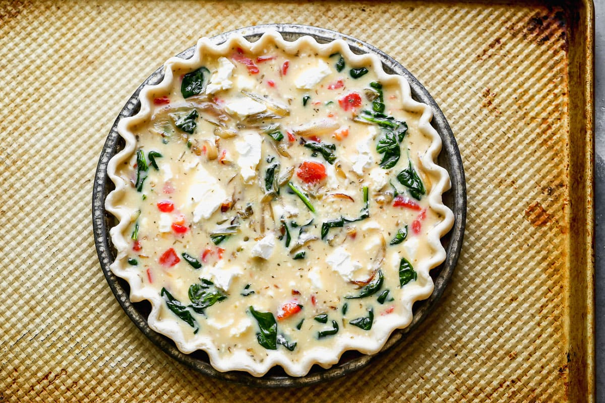 An unbaked goat cheese quiche