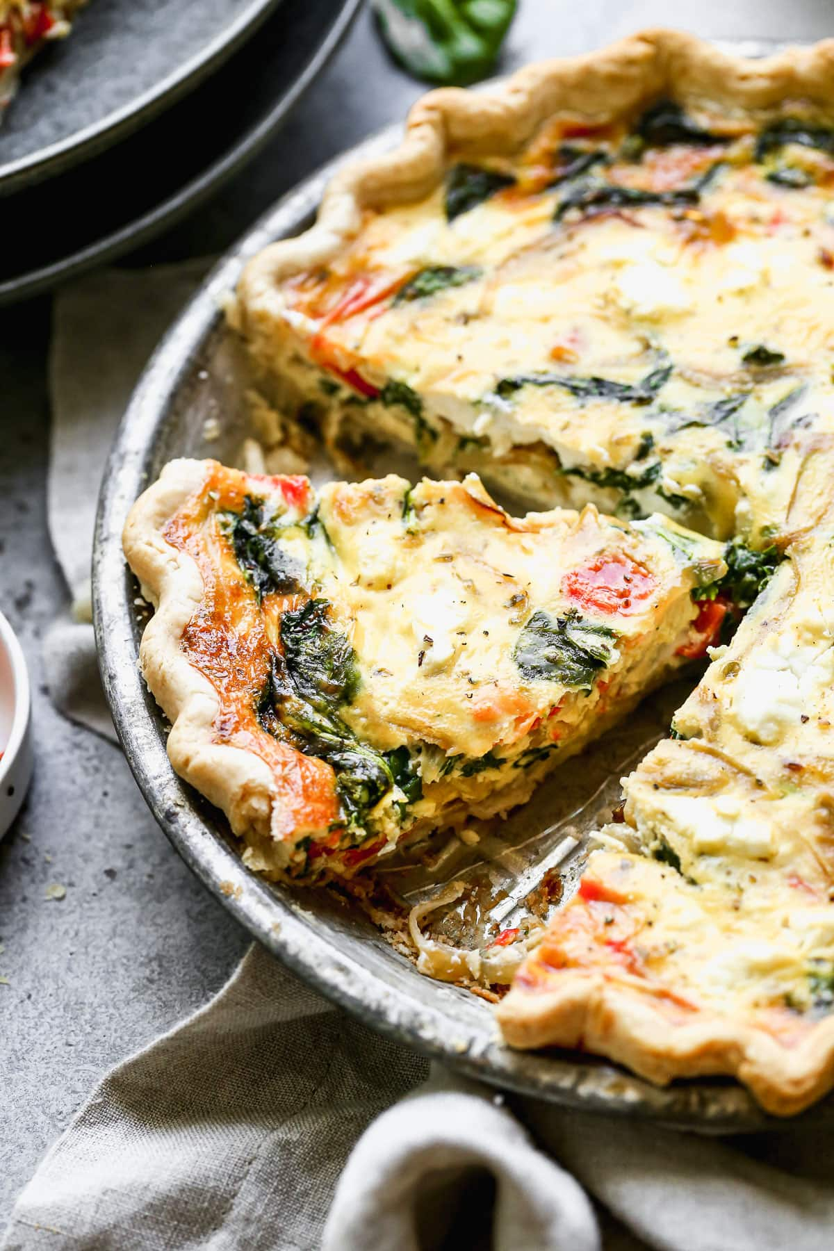 Sliced goat cheese quiche with spinach