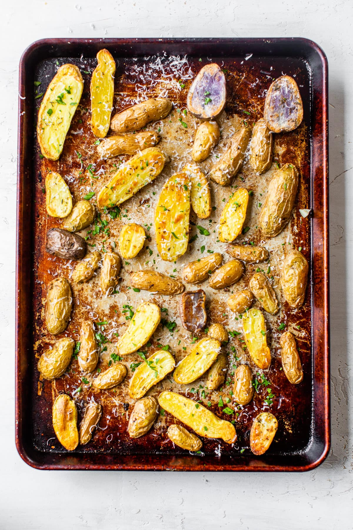 Roasted fingerling potatoes on a baking sheet