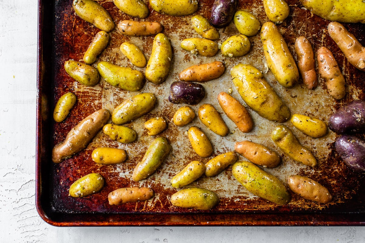 Halved vegetables on a baking sheet