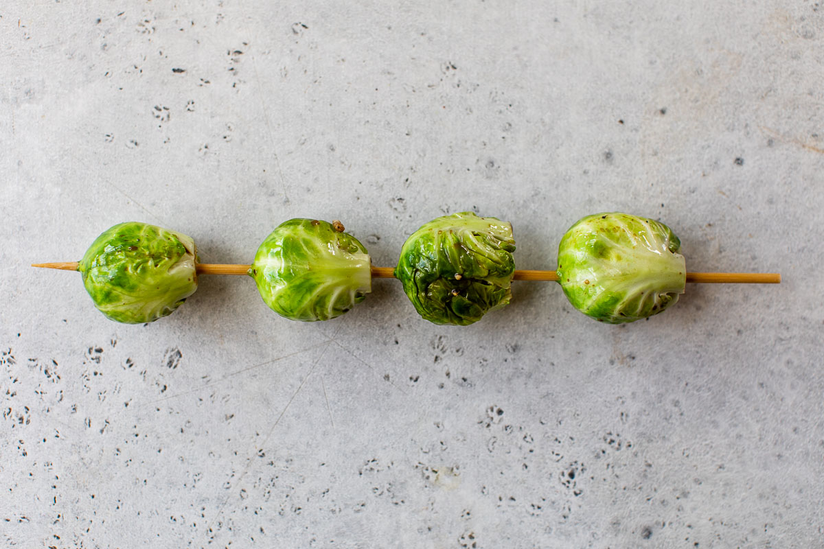 Brussels sprouts on a wooden skewer