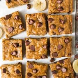 Healthy Banana Bars with Chocolate Chips. Moist, chewy, and easy to make. Kids love them and they are perfect for healthy desserts and snacks! Top with peanut butter frosting or brown butter frosting or enjoy them just as they are. One of the best skinny dessert recipes!