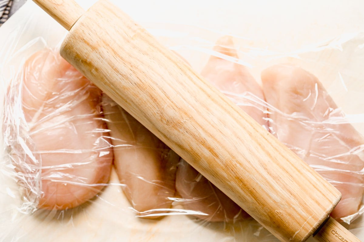 Chicken breasts being pounded