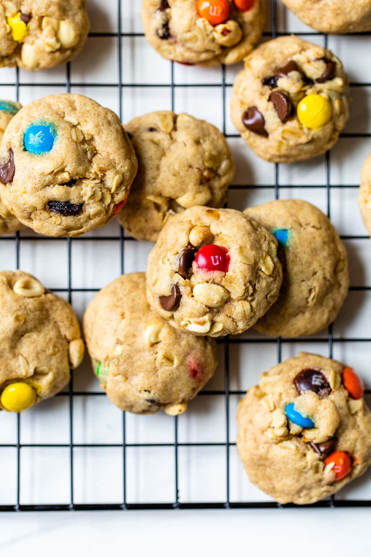 A stack of trail mix cookies with peanuts and chocolate