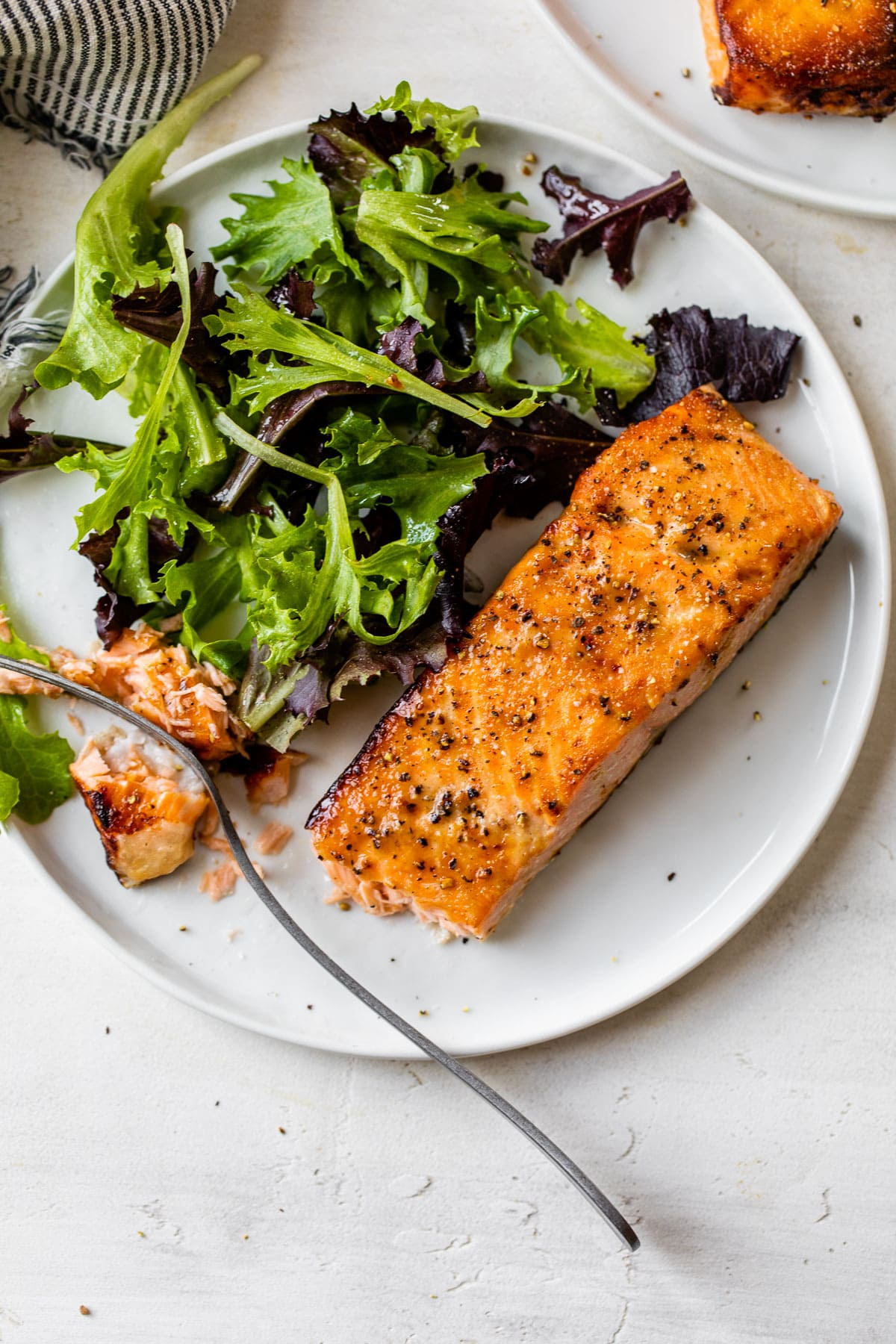 Salad and air fryer salmon on a plate