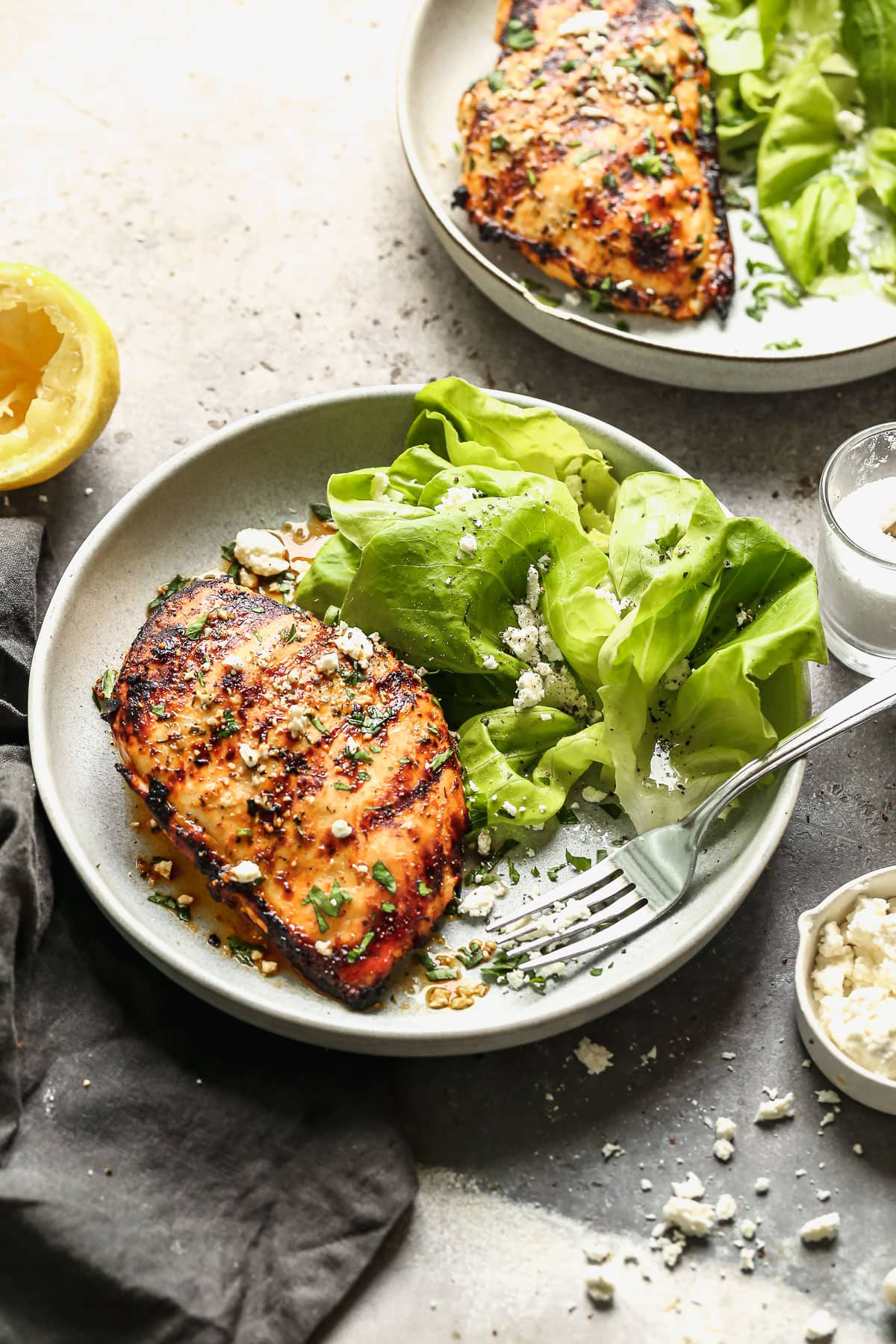 Grilled chicken breast and salad on a plate