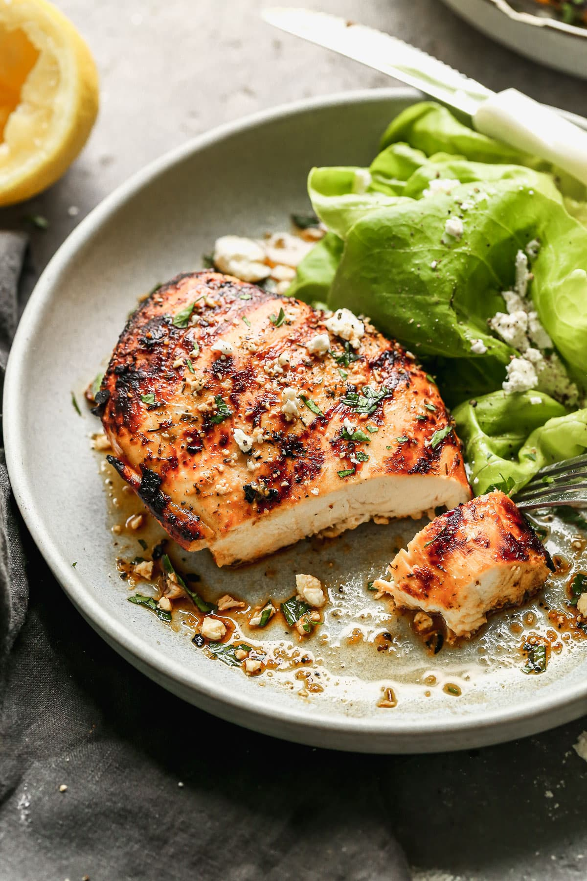 Healthy grilled chicken breast and salad on a plate