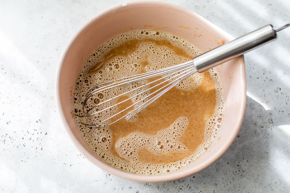 a bowl with oatly for making oat milk ice cream