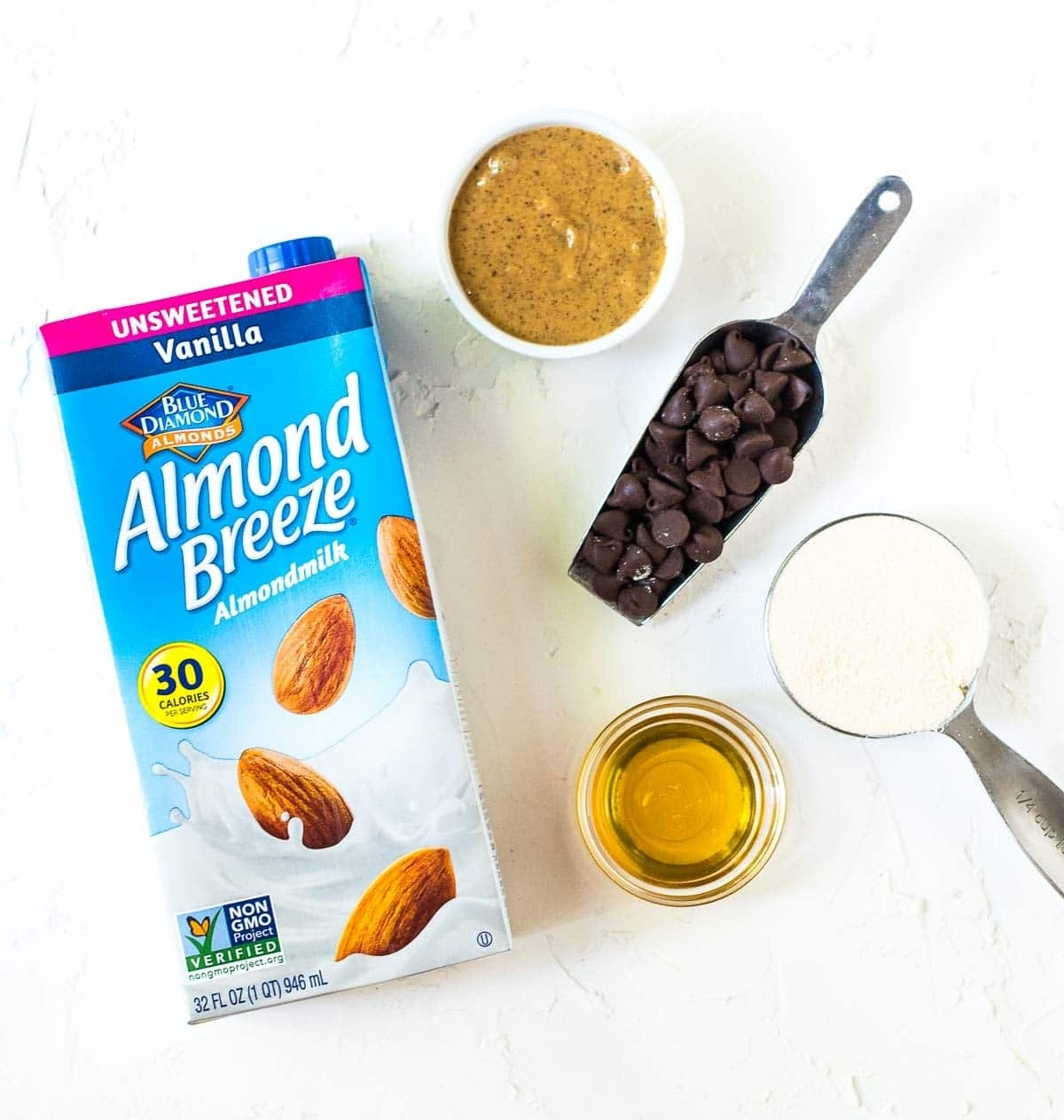 almond butter, honey, chocolate chips, and protein powder, and almond milk for making protein balls