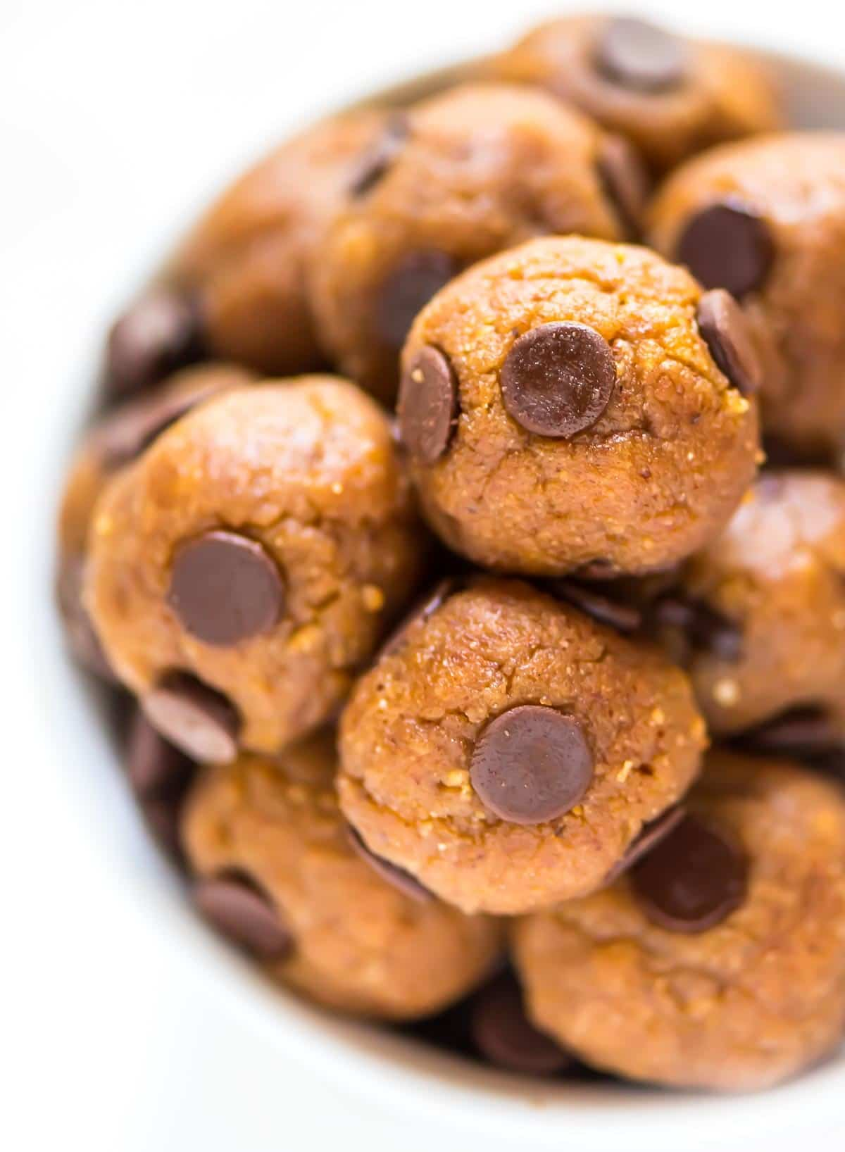 a bowl of chocolate chip protein balls