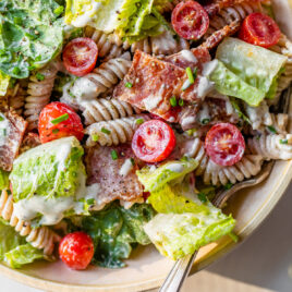 blt pasta salad with dressing and spinach