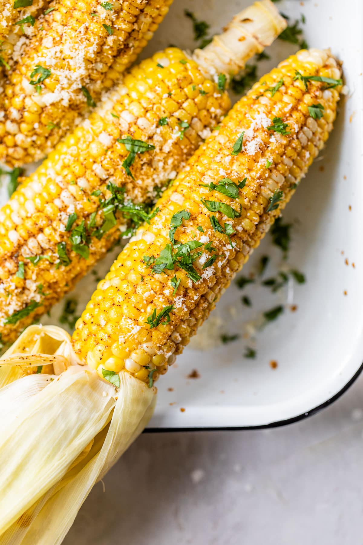 Corn on the grill with the husk on