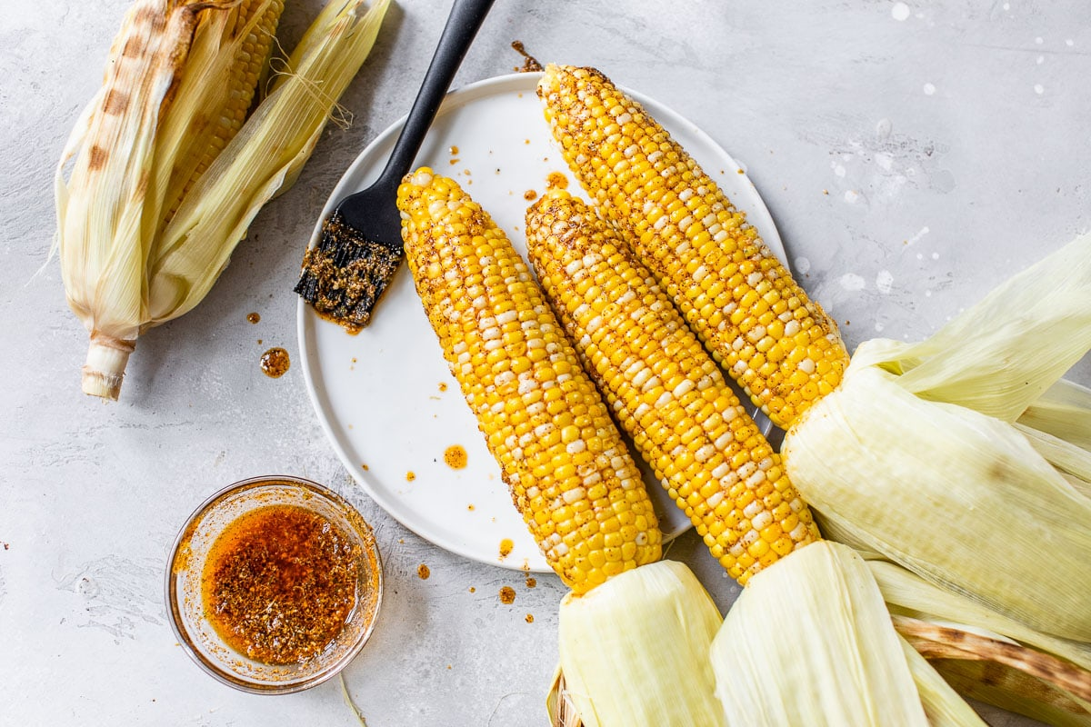 grilled corn with butter and Mexican spices