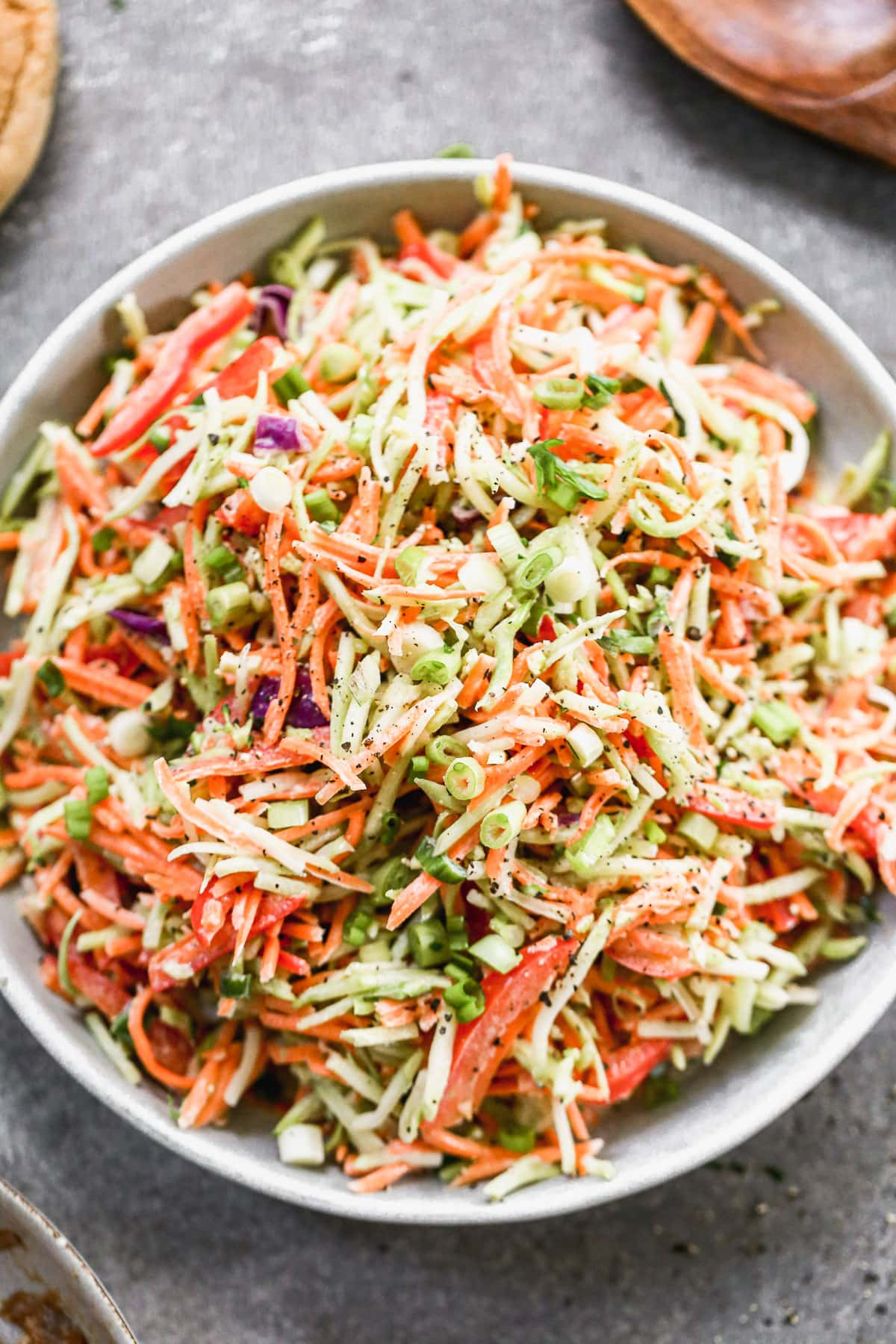 easy healthy coleslaw recipe ingredients mixed in a bowl