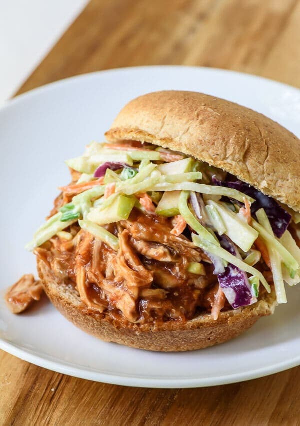 A plate with BBQ pulled chicken sandwich