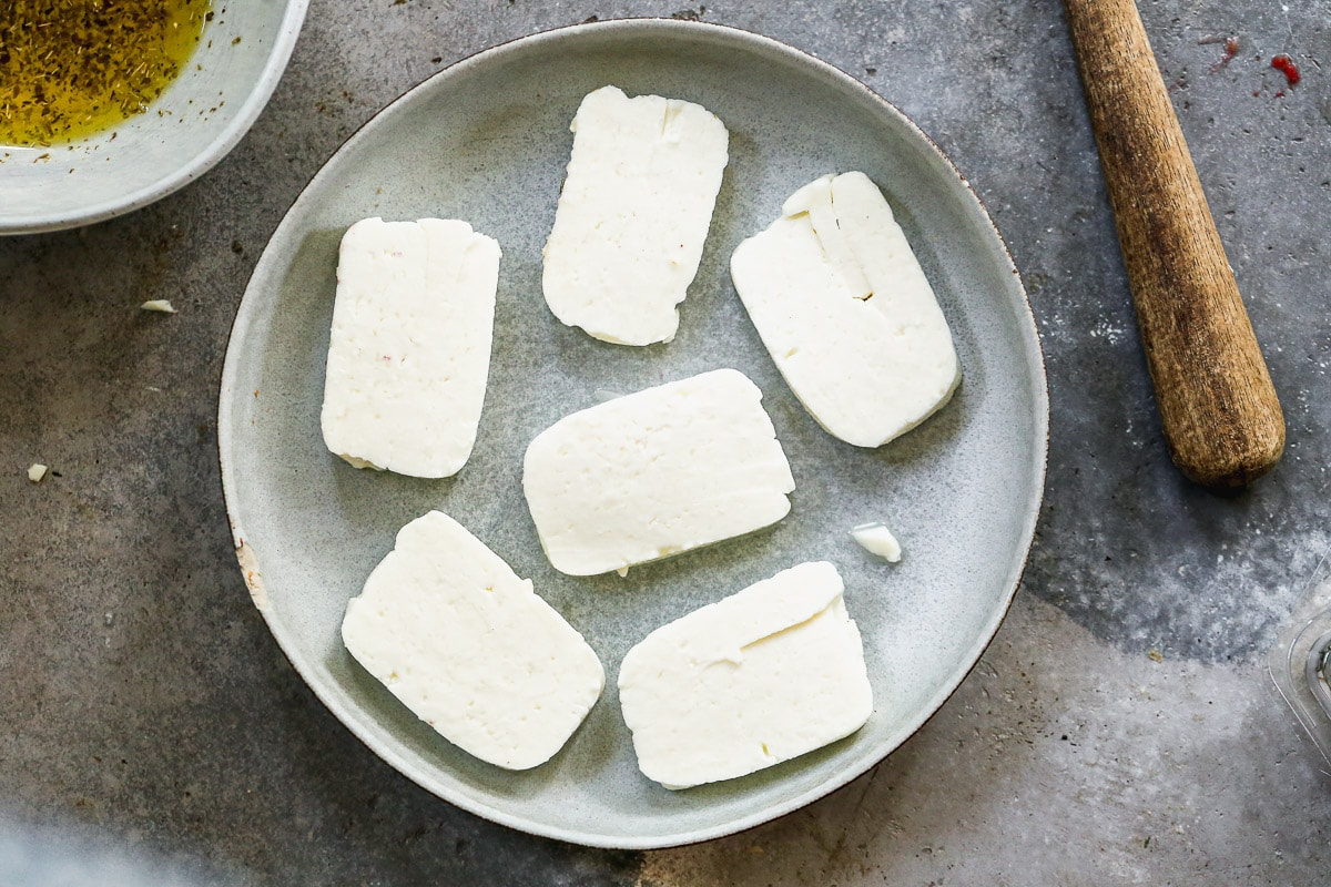 sliced halloumi with olive oil ready to be grilled