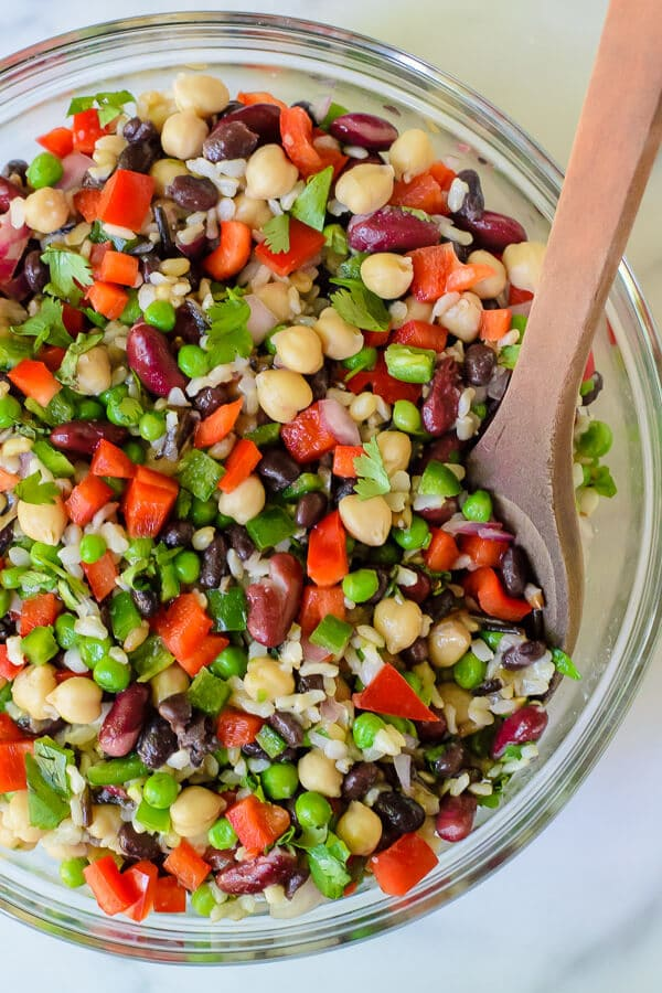 Three Bean Salad with Wild Rice, jalapeno, red pepper and peas in a glass bowl