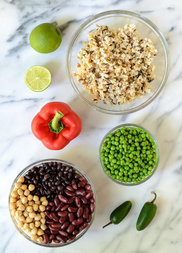 Ingredients for easy three bean salad on a marble countertop