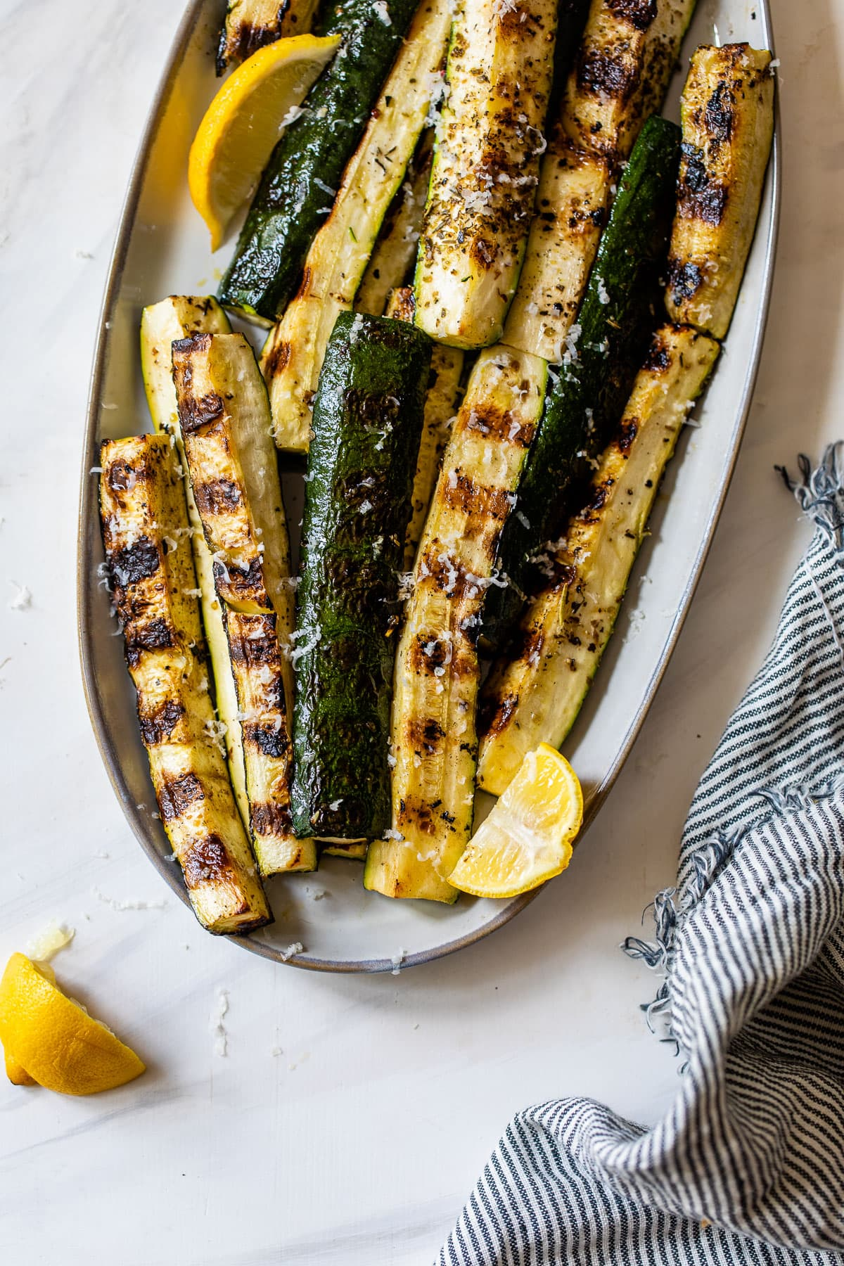 seasoned grilled zucchini without foil on a plate