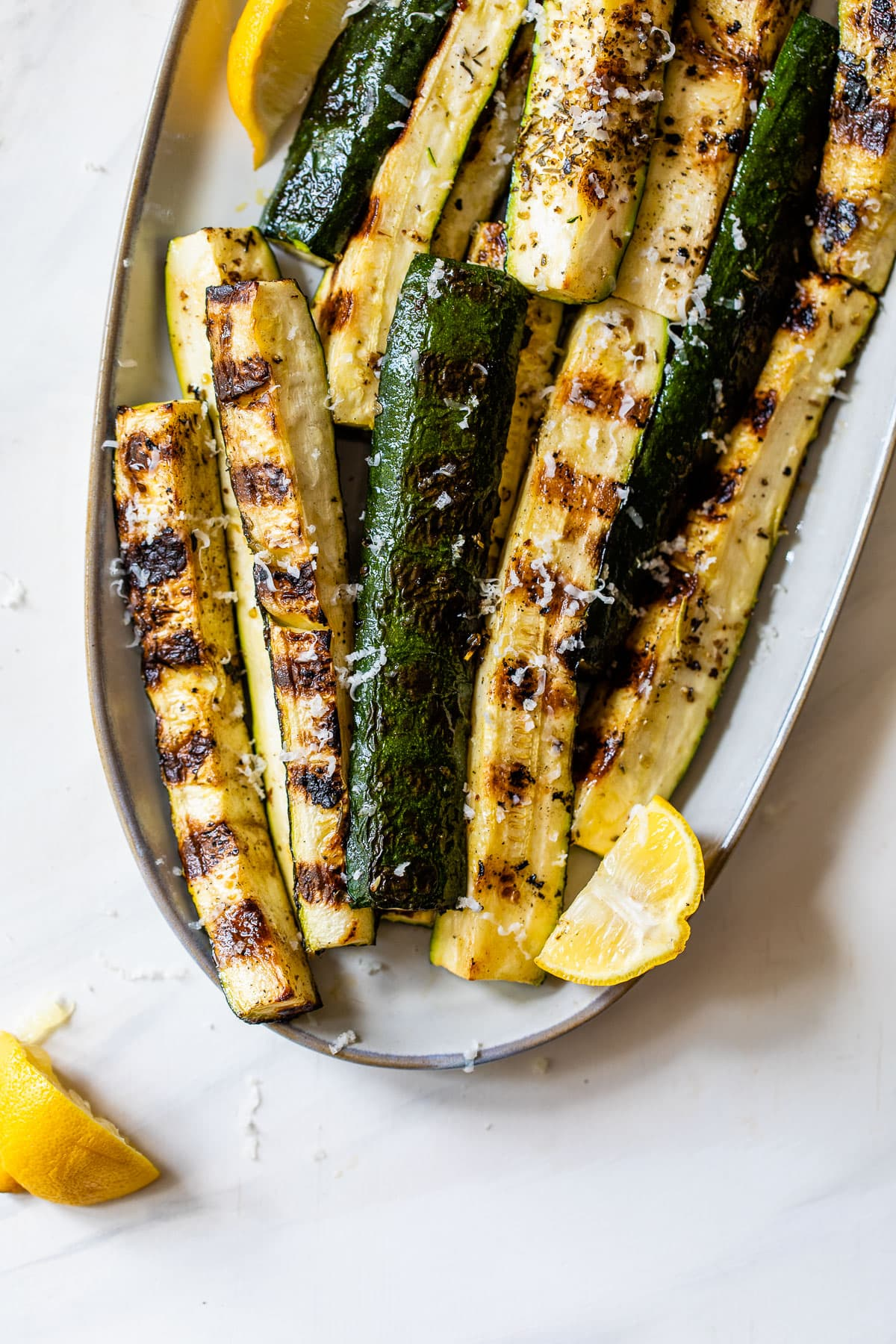 grilled zucchini with Parmesan on a plate