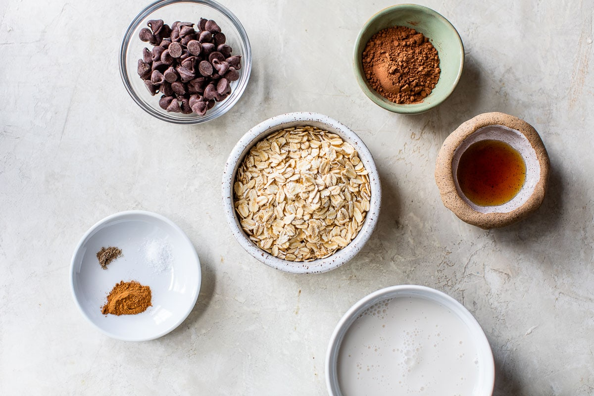 ingredients for chocolate oatmeal on a stone surface