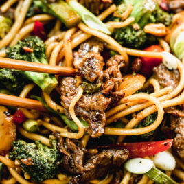 beef and broccoli lo mein with noodles on a plate