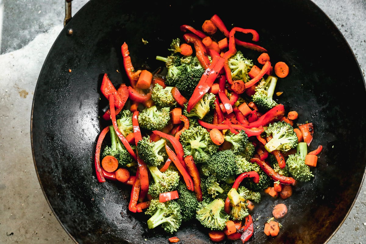 broccoli and vegetables for beef lo mein in a skillet