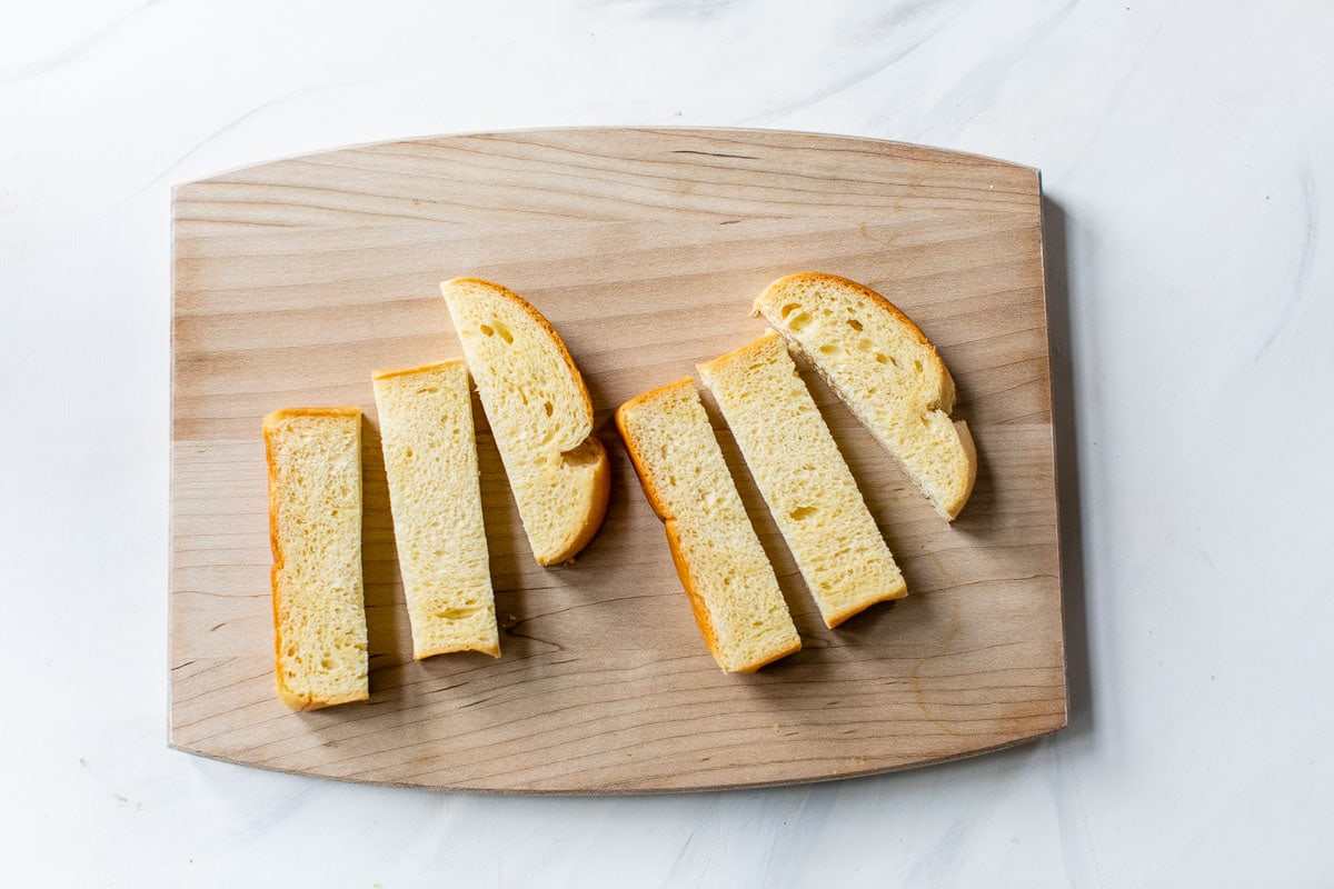 bread slices on cutting board for french toast sticks