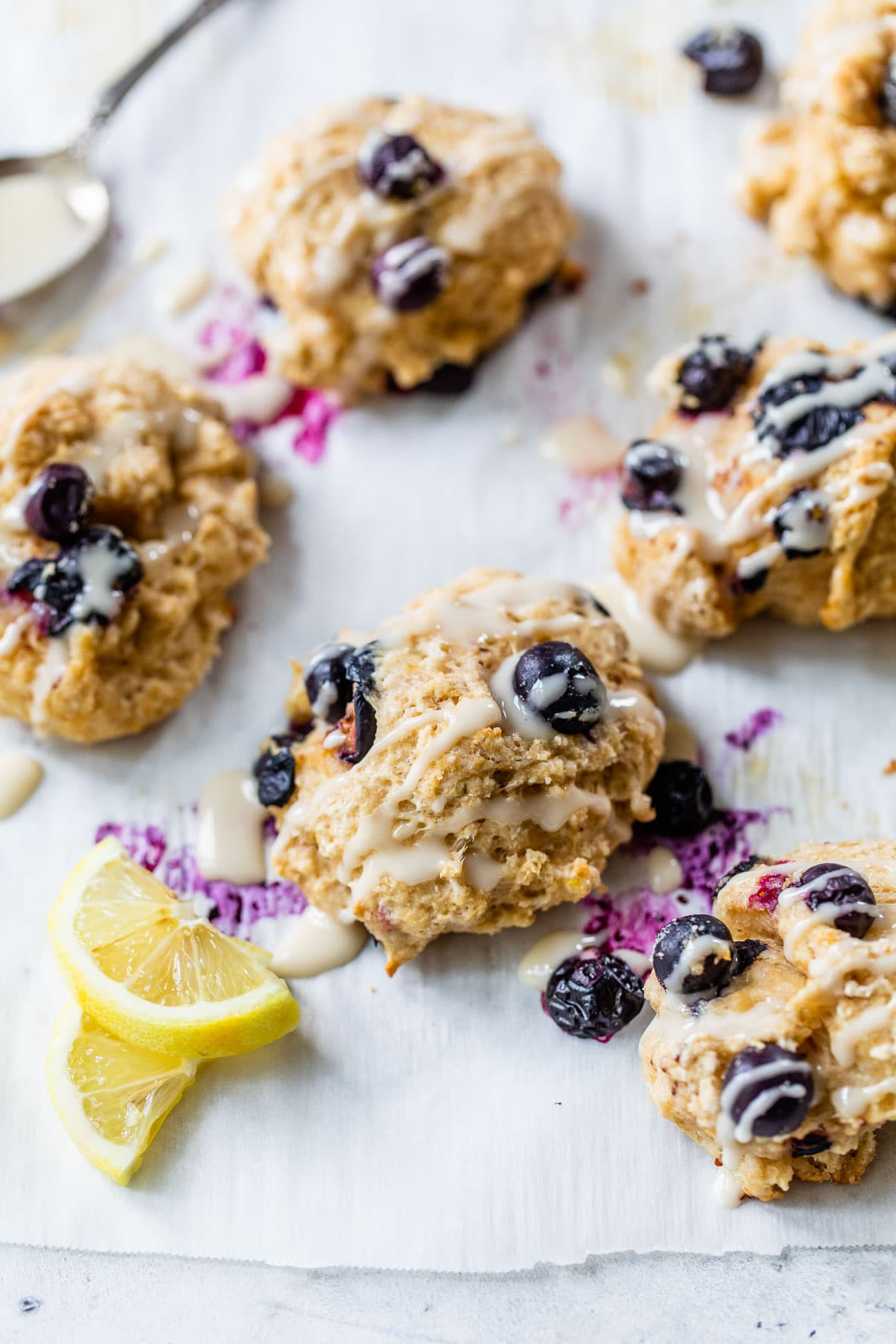 Fluffy healthy lemon blueberry biscuits with glaze on top