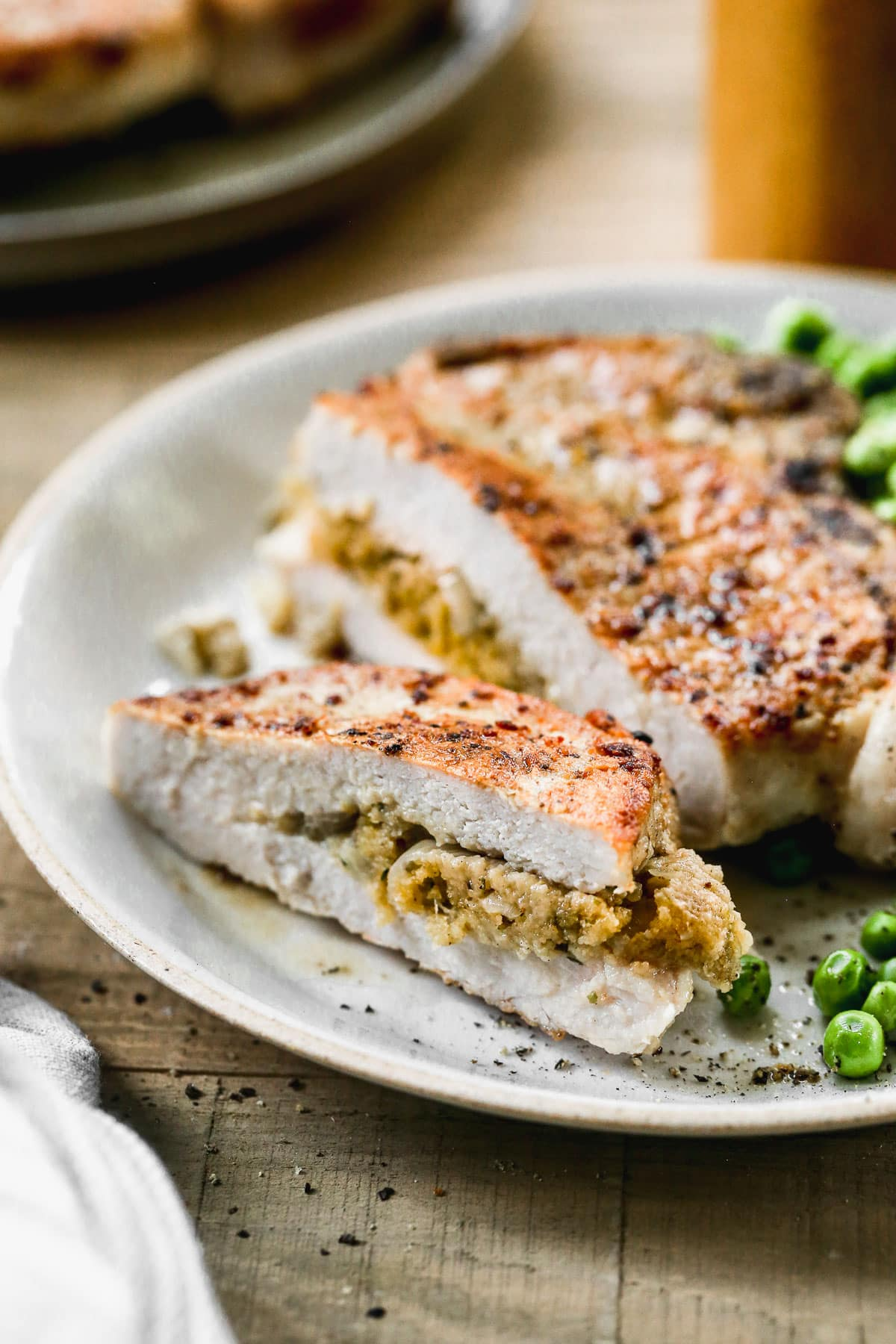 stuffed pork chops with cheese on a plate