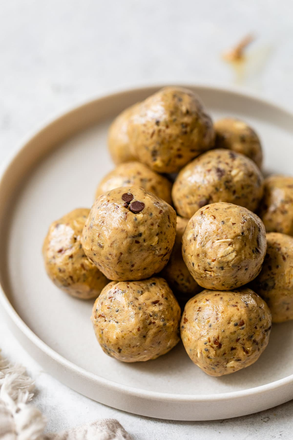 peanut butter protein balls with honey and chia seeds on a plate