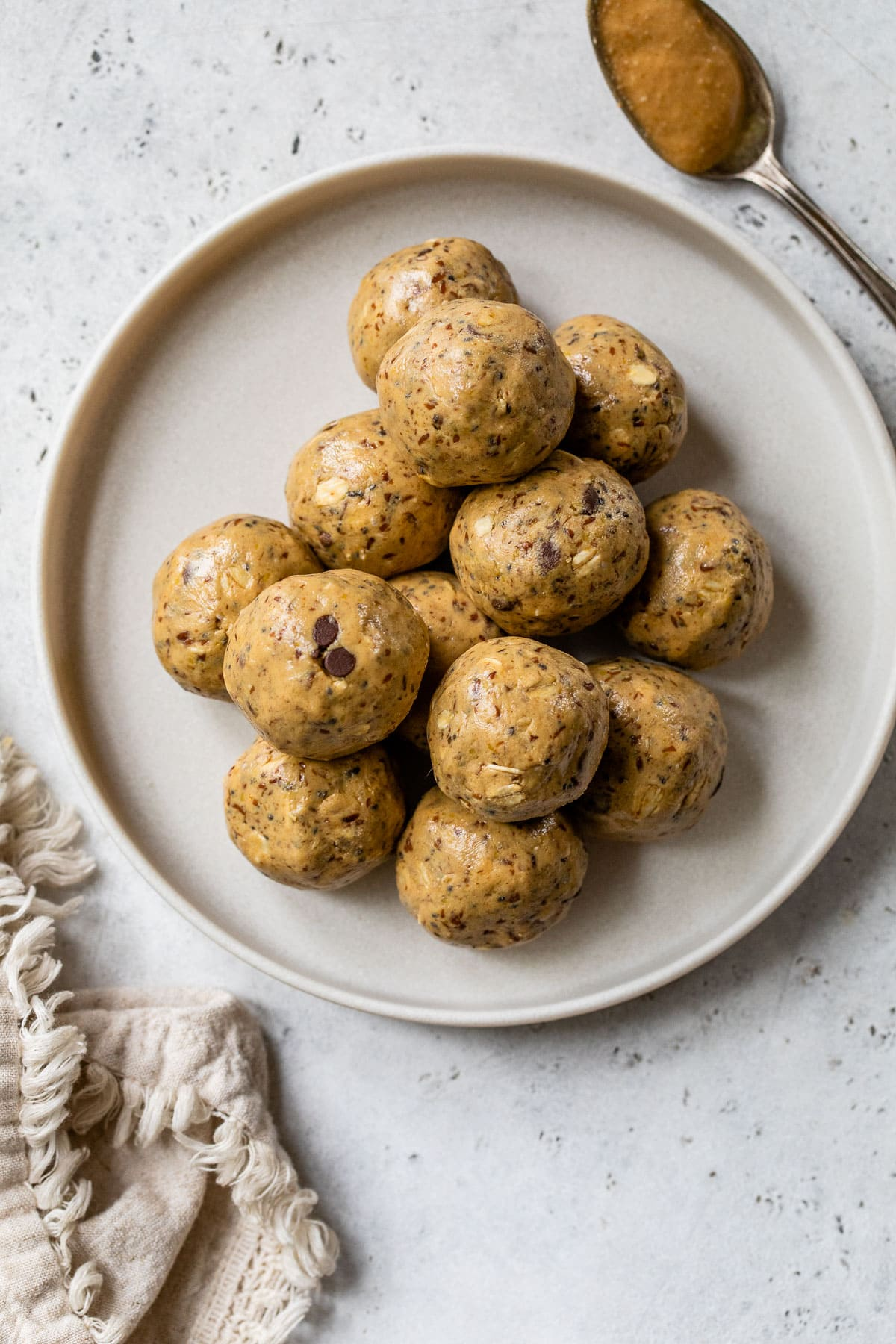 healthy peanut butter protein balls for a snack on a plate
